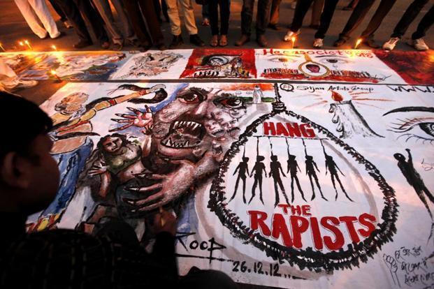 Artists paint posters to seek capital punishments for rapists while protesting against gang-rapes. Photo: Raj K Raj/Hindustan Times (Raj K Raj/Hindustan Times)